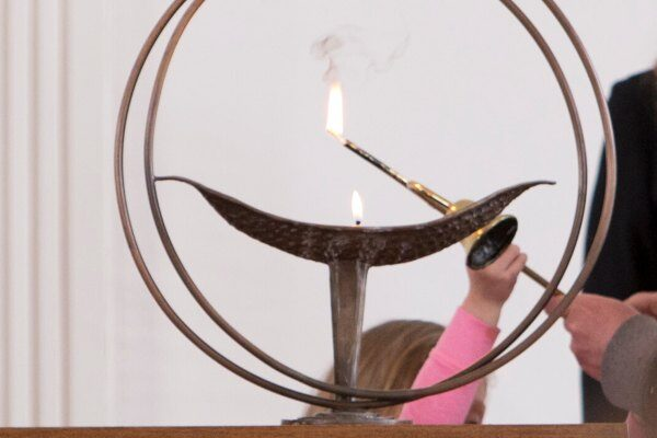 Chalice being lit by child