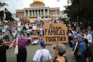 Immigration Justice Team at Statehouse with Keep Families Together Sign