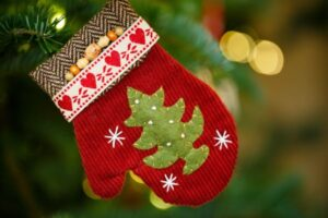 Red mitten with green tree on it