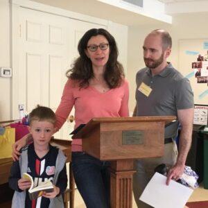 Lara Crawford and son at lecturn